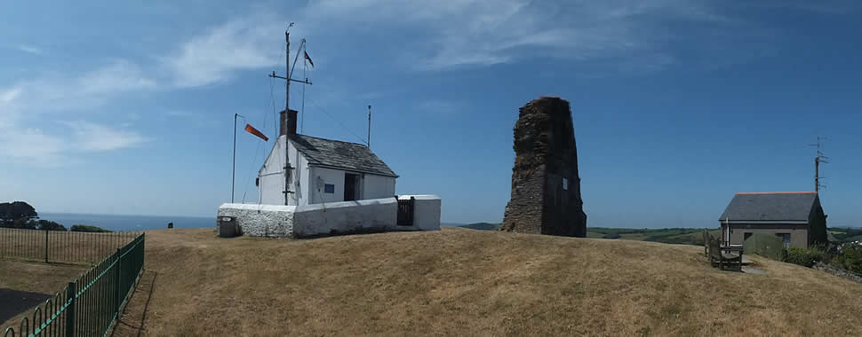 The NCI Polruan Lookout Station alongside St Saviours Chapel ruins stand on the hill high above Polruan